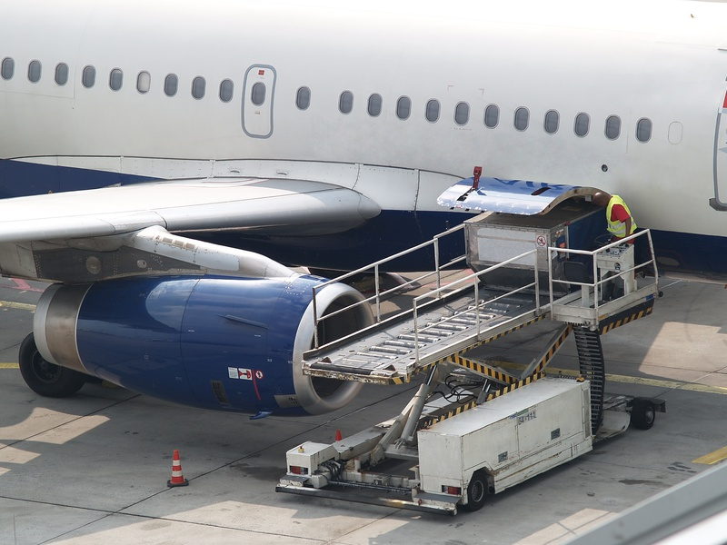 Worker loading aircraft