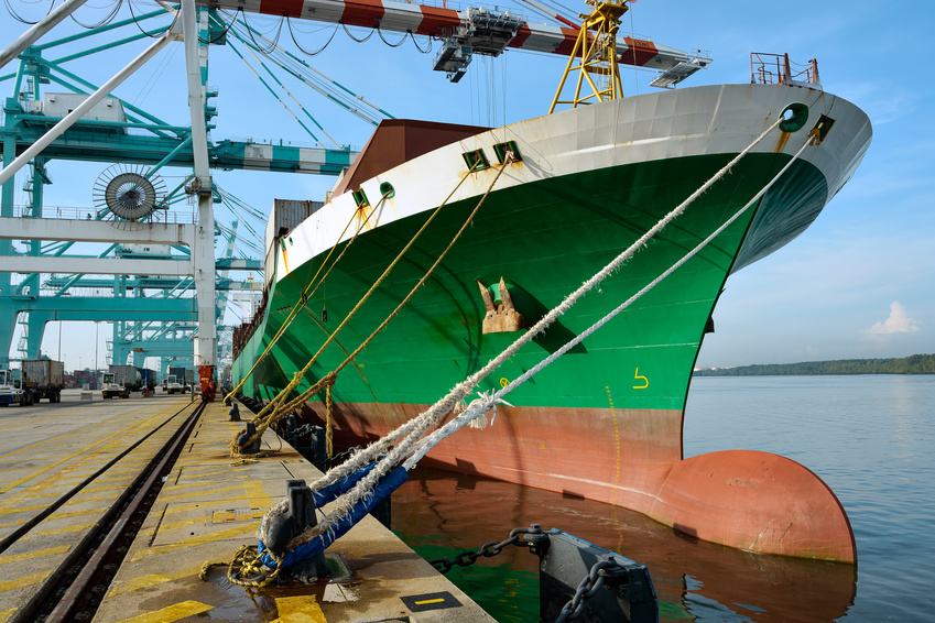Large cargo ship being loaded in a port Johor, Malaysia